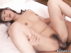 Truly innocent Japanese bitch is being screwed by a dildo