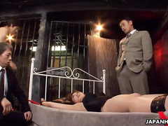 Two gentlemen are treating a lusty Japanese mature