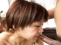 Asian woman sucking rod and showing her both slits