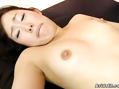 Asian girl shows her hairy pussy between legs