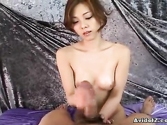 Hot chick wanks dick and rubs it against small tit