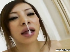 Fresh semen is in the Asian horny mouth