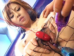 Babe toy fucked through the fishnets in pantyhose
