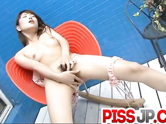 Small titted Japanese masturbating her clit slit