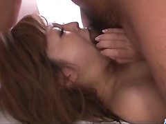 Busty Japanese has kinky fun with two hard dudes