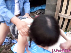 Two guys are penetrating an Asian babe from the both sides