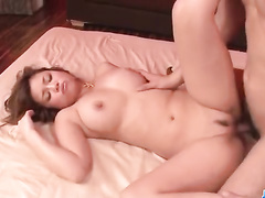 Busty Asian babe in fishnet stockings gets fucked by two dudes