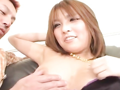 Japanese chick is getting undressed on couch and fucked hard