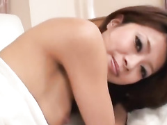 Charming sexy brown haired Asian babe is getting hotly excited and fucked