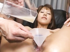 Slender brown haired babe gets her pussy filled up with milk