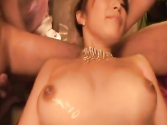 Sexy boobed Asian chick enjoys satisfying two guys
