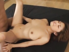 Brown haired Asian babe with hot breasts sucks dick