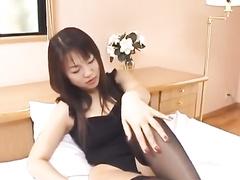 Oriental fucker fondles sexy girlfriend in black stockings