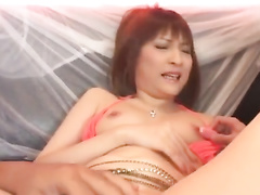 Charming oriental girl enjoys pleasant pussy masturbation from boyfriend