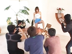 Red haired Japanese girl sexily undresses and poses in front of cameras