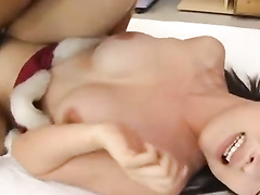 Asian girl in Christmas suit is having cunnilingus before fucking