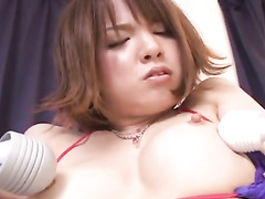 Hot young Japanese chick is exciting from being stroked with vibrator