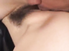 Naughty Japanese dude bends over hot chick and licks her cunt