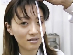 Charming hot Japanese chick is being undressed and measured
