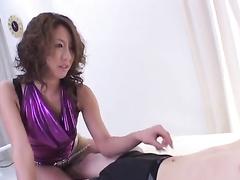 Curly Japanese slut excitingly sucks big dick