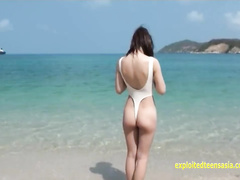 Naughty Japanese teen chick Mirai Arisa pulls her bikini to show cameltoe