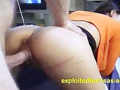 Slender young Asian brunette chick Sally is pleasuring hardcore doggy style fuck